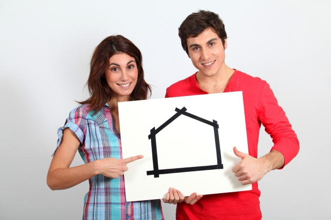 bigstock-Young-couple-buying-new-house-17006093